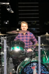 Matt at Derrick McKenzie's drum kit, on stage at Manchester Arena